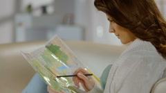 Pretty lady planning trip for weekend, vacation, studying map Stock Footage