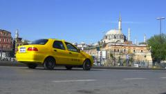 Rustem Pasha Mosque and traffic on Ragip Gumuspala Cad at Eminonu Stock Footage