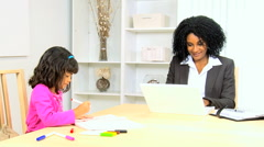 business female African American young child home laptop smart phone wireless - stock footage
