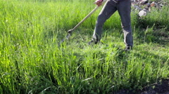 Scythe to mow the grass Stock Footage