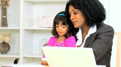 Business female African American young child home laptop smart phone wireless Stock Footage