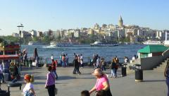 People at Eminonu Pier looking to Goldenhorn Stock Footage