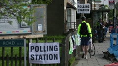 Polling Station - Voters cast their vote on election day Stock Footage
