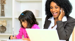 Independent female African American consultant laptop smart phone infant child Stock Footage