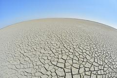 Wide Angle View of Cracked Dry Ground, Curved Horizon, Saintes-Maries-de-la-Mer, - stock photo