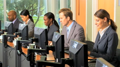 Multi ethnic male female business financial stock advisor computer technology Stock Footage