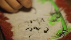 """The Vietnamese calligraphy. Wishes: """"happiness, health and prosperity"""" - stock footage"""