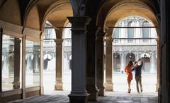 Couple dancing in archway in Venice Stock Photos