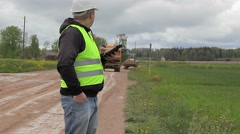 Engineer with tablet PC in road repairs Stock Footage