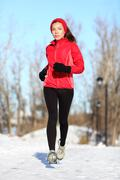 Sport woman running in winter -  Female runner portrait - stock photo