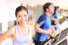 Fitness people portrait in gym - woman on treadmill in fitness center Stock Photos