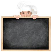 Chef showing restaurant menu blackboard - empty blank with copy space for tex Stock Photos