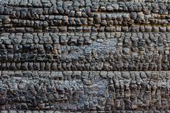 Burned timber wall Stock Photos