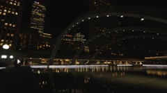 Toronto Nathan Phillips Square Night Pond Arches Pan Stock Footage