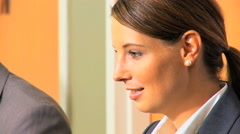 Caucasian male female business financial stock advisor computer technology - stock footage