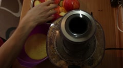 Fresh apple juice extracted with squeezer Stock Footage