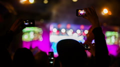 Two People Taping Concert In The Crowd Waving Flags Stock Footage