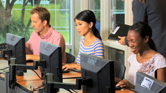 Male female multi ethnic mature business student computer technology classroom Arkistovideo