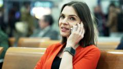 Young, attractive woman talking on cellphone at the train station HD Stock Footage
