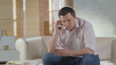 Young man talking to business partner on phone, ending call Stock Footage