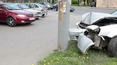 Deformed body of the taxi car is on the sidewalk after hit into pole, Russia Stock Footage
