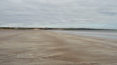 Waves breaking on beach Lunan Bay Scotland Stock Footage