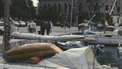 Yugoslavia 1970s: people walking in front of a seaport - stock footage