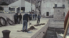 Stock Video Footage of Yugoslavia 1970s: fishermen mending nets