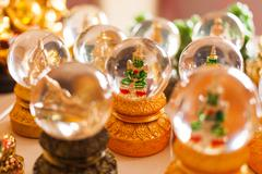 Stock Photo of Souvenir for luck - one of buddhism gods in crystal ball. Golden mountain, Ba