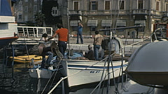 Yugoslavia 1970s: sailor men in the port Stock Footage