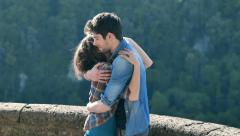 best friends: man and woman embracing in slow motion - stock footage