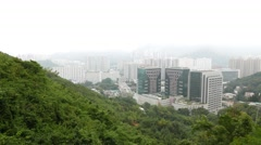 Foggy chinese city view from mountain side, buildings and pagoda Stock Footage