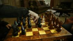 Player makes his move on chessboard at chess game challenge Stock Footage