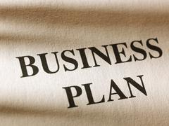"""The inscription """"business plan"""" on a sheet of paper. - stock photo"""