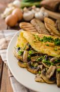 Rustic omelette with mushrooms on chives Stock Photos