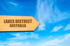 Wooden arrow sign pointing touristic destination - stock photo