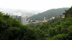 City view from mirador on mountainside, woodland slopes and buildings Stock Footage