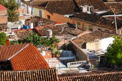 Colonial town cityscape of Trinidad, Cuba. UNESCO World Heritage Site. Greeti - stock photo