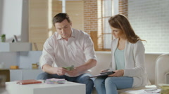 Happy man and woman counting money, lottery win, success, wealth Stock Footage