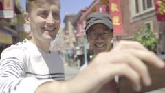 Gay Couple Run Into The Street To Take A Selfie With Red Chinese Lanterns(4K) Stock Footage