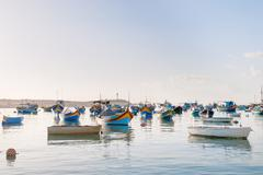 Colorful typical boats - Mediterranean traditional fisherman village in the s - stock photo