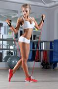 Sportive woman doing skipping rope exersise in the gym Stock Photos