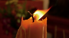 Close-up of candle wick and match - stock footage