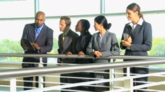 African American Caucasian Asian Chinese business office atrium wireless tablet Stock Footage