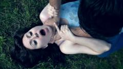 Violence on a woman: man is trying to kill a woman suffocating her Stock Footage