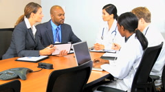 Multi ethnic male female medical consultant manager finance planning technology Stock Footage