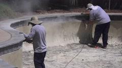 Stock Video Footage of Men preparing swimming pool to resurface