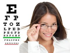 Optometrist or optician with eyewear glasses - mixed Asian woman Stock Photos