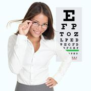 Optometrist / optician wearing eyewear glasses - Asian woman - stock photo