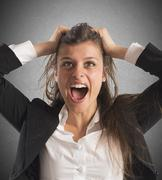 Furious businesswoman screams - stock photo